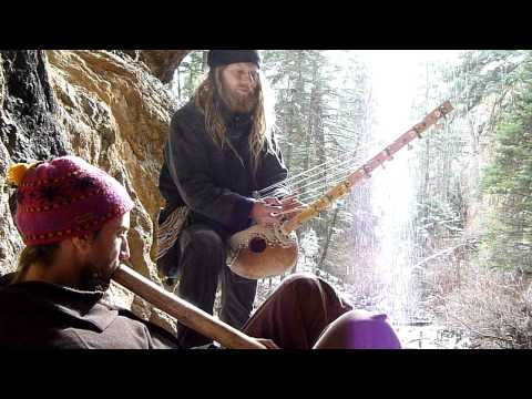 Eric_Mandala_playing_N_goni_in_Taos_by_the_waterfall_with_Will_i_am_on_Didgeridoo