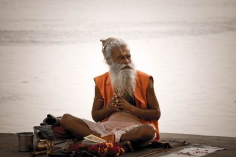 a_sadhu_by_the_ghats_on_the_ganges_varanasi